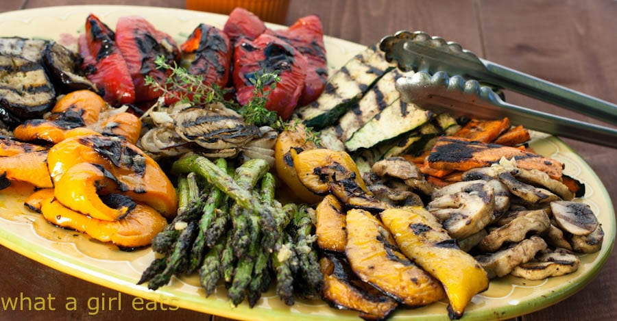 grilled asparagus and bell peppers on a yellow platter