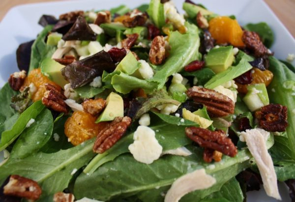 Field greens chicken salad is a delicious and healthy salad, topped with tender chicken breast, blue cheese, and candied pecans.