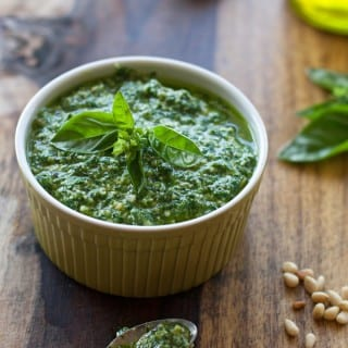 Fast and Easy 5 Minute Homemade Basil Pesto. Perfect on pasta or spaghetti squash for a low-carb dish! | Recipe on WhatAGirlEats.com