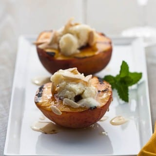 Grilled peaches, filled with slightly sweetened Mascarpone cheese, drizzled with a bit of honey, topped with either almonds or lavender. The choice is yours, because here are both recipes! | from @whatagirleats