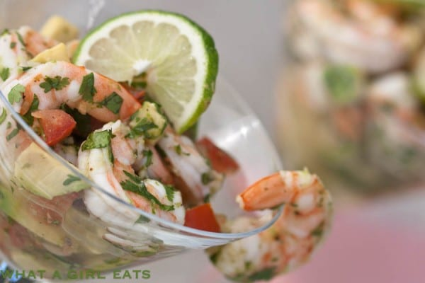 Ceviche shrimp cocktail is a delicious and easy to make appetizer, with shrimp, avocado, tomato, and fresh herbs. Get the recipe from WhatAGirlEats.com