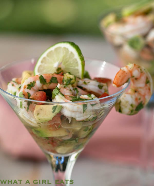 Ceviche shrimp cocktail (also known as seviche or cebiche) is a delicious and easy to make appetizer, with shrimp, avocado, tomato, and fresh herbs. Get the recipe from WhatAGirlEats.com