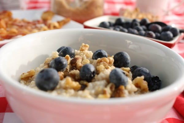 A healthy bowl of oatmeal, topped with blueberries