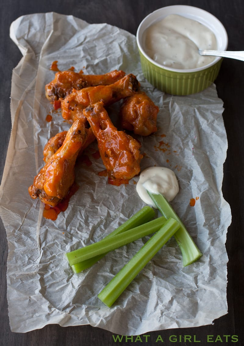 Buffalo hot chicken wings with blue cheese dressing and celery sticks…perfect football food!