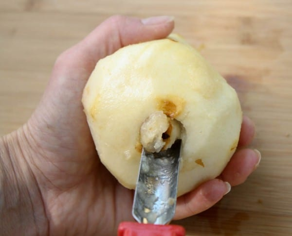To make poached pears, core pears from the bottom, leaving the whole pear intact.