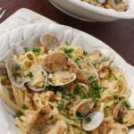 Pasta al Vongole, also known as linguine with clam sauce, is an Italian pasta dish, made with tender sauteed clams and a flavorful white wine sauce. It is quick and easy to prepare, making it perfect for a weeknight dinner. | from @whatagirleats