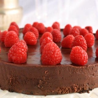 Gluten free dark chocolate Flourless cake with dark chocolate ganache. @whatagirleats.com