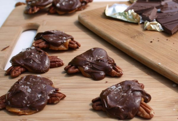 Sea Salt Caramel Pecan Turtles - The perfect candy to make and give as holiday food gifts, or to snack on any time of the year! Recipe on WhatAGirlEats.com