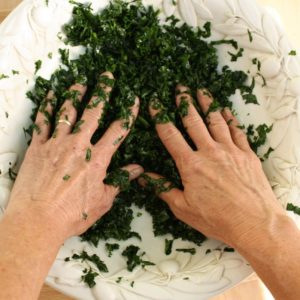 "Kale salad getting a ""massage""."