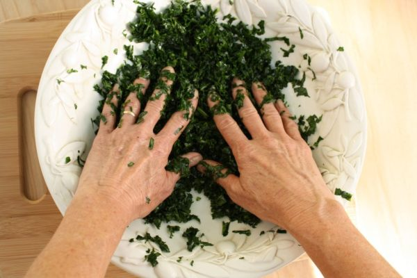 "Kale salad getting a ""massage""."