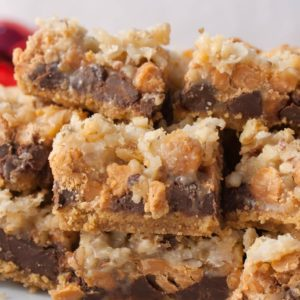 """Seven Layer Bars, """"Magic Bars.This classic dessert is just 7 ingredients and is a holiday staple in our house!"""