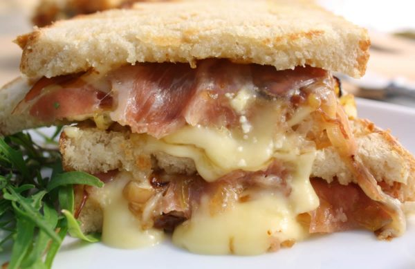 Brie and prosciutto Panini, with fig jam and caramelized onions | WhatAGirlEats.com