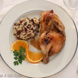 Fantastic slow cooker recipe for Grand Marnier Cornish Game Hens and Wild Rice with Cranberries and Pecans. The perfect easy holiday dinner recipe! @whatagirleats.com