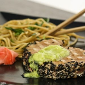 Seared Ahi Tuna with Wasabi Butter and garlic noodles. Recipe on WhatAGirlEats.com