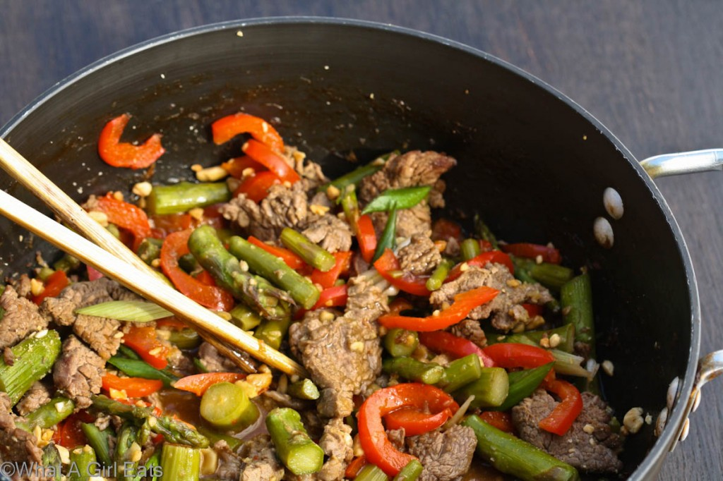 Szechuan beef is a popular, spicy Asian stir fry that's quick and easy to make. This version is accented with sweet red bell pepper and fresh asparagus.