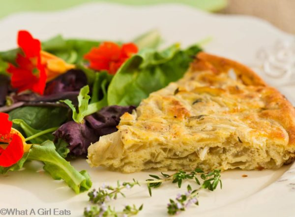 Crustless onion quiche is a quick, easy, wheat free meal. It's delicious, healthy, and versatile enough to be eaten for any meal of the day! | WhatAGirlEats.com