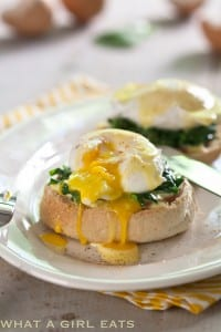 Eggs Florentine, poached eggs on a bed of spinach and canadian bacon topped with easy blender hollandaise sauce.