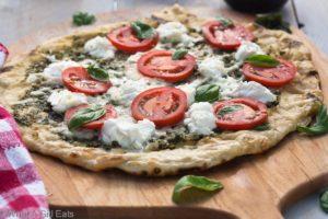 Grilled pizza with pesto, ricotta and smoked mozzerella.