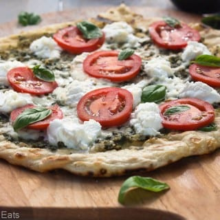 Grilled pizza with pesto, ricotta and smoked mozzerella.
