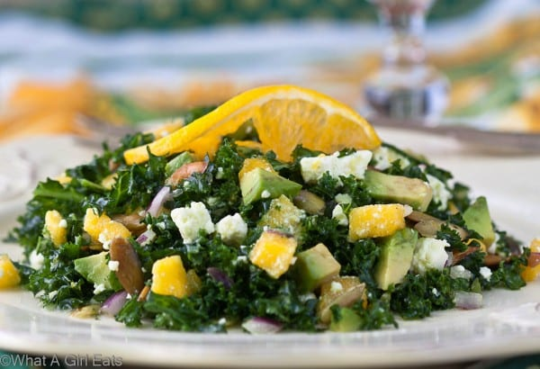 Kale salad with mango, avocado, and feta. Full of flavor, this salad is perfect as a side dish, or a complete meatless meal.