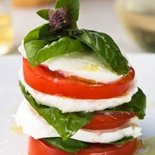 Caprese salad brings the flavors of garden fresh tomatoes, soft mozzarella, and fresh basil together for a delicious, light summer meal.
