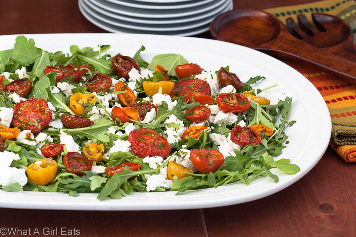 Moonblush Tomato Salad is the perfect light meal, using fresh garden tomatoes, healthy arugula, mint, and creamy goat cheese! | from @whatagirleats