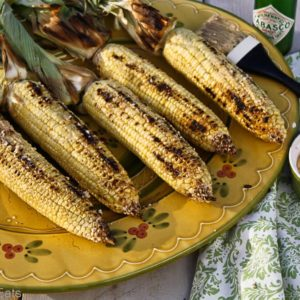 Mexican style corn on the cob, made with chile-lime Parmesan butter, is one of the most delicious ways to eat grilled corn on the cob. | @whatagirleats