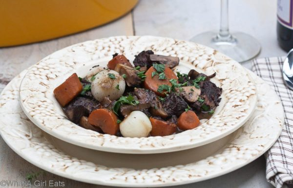 Boeuf bourguignon, also known as burgundy beef, is a rich, hearty beef stew. It is the perfect Sunday supper or meal for any special occasion. | @whatagirleats