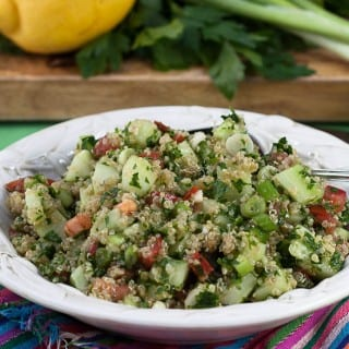 Quinoa Tabbouleh is a healthy, gluten free side dish that's packed with flavor and texture!   @whatagirleats