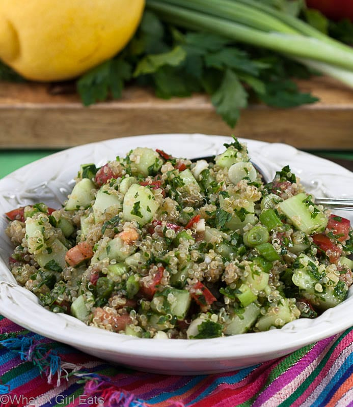 Quinoa Tabbouleh is a healthy, gluten free side dish that's packed with flavor and texture! | @whatagirleats
