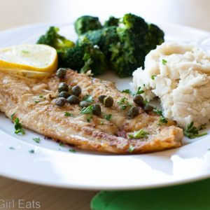 Pan-Fried Dover Sole with Capers and Lemon is a fast and easy-to-make fish dish for a busy weeknight. This meal comes together in less than 30 minutes! | What a Girl Eats