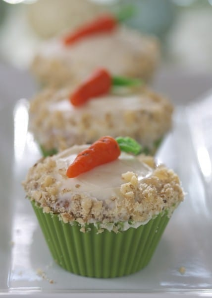 Carrot cake cupcakes are miniature versions of classic carrot cake. Moist carrot cake topped with creamy, decadent cream cheese frosting. The perfect gluten free Easter dessert!