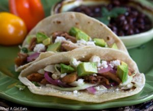 Chicken tacos with cilantro slaw and pickled onions