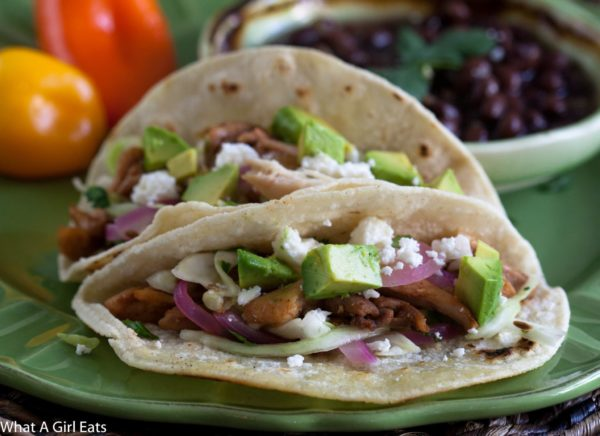 Chicken Tacos with Pickled Onion and Cilantro Slaw are a quick and easy, healthy taco dinner with a taste a step above the ordinary taco. | @whatagirleats
