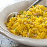 Easy Golden Rice Pilaf - An easy and healthy Mediterranean side dish, flavored with tumeric and pine nuts.