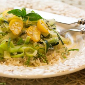 Zucchini saute is an easy to prepare dish that can be served as a side or as part of a complete meatless meal. Zucchini, cherry tomatoes, fresh herbs and a sprinkle of Parmesan on top.   WhatAGirlEats.com