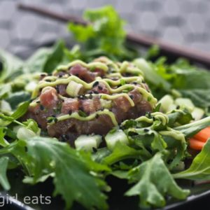 Tuna Tartare with Avocado Wasabi Cream on a bed of baby greens is a perfect weeknight dinner. Light and refreshing, this Five Happiness Salad is restaurant quality, made at home. | WhatAGirlEats.com