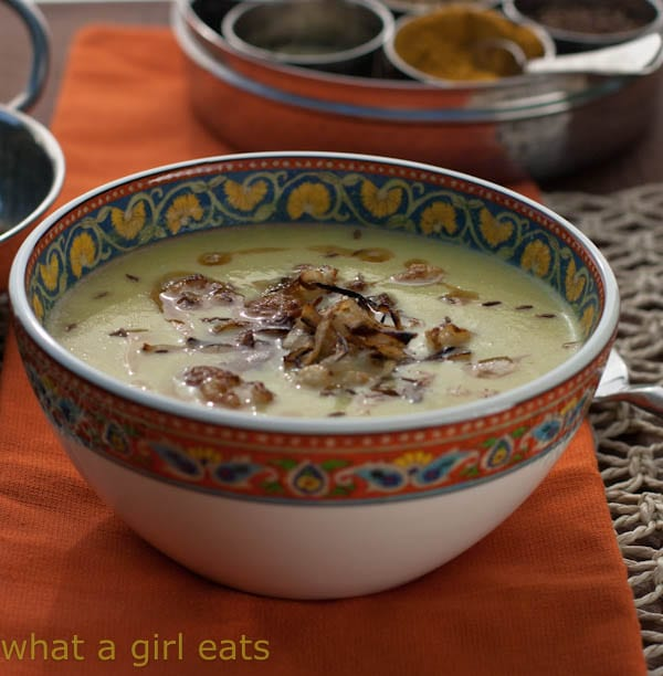 Curried Cauliflower Soup with Crispy Onions is not only creamy and delicious, it's also Paleo, vegetarian, and gluten free! | WhatAGirlEats.com
