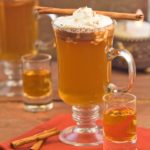 Hot Apple Pie cocktail is one of my favorite cool-weather drinks! Lightly sweetened and seasoned apple cider and Calvados are warmed and served with fresh whipped cream.