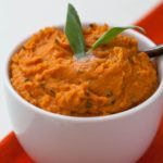 Browned butter mashed sweet potatoes with sage is an easy Thanksgiving side dish recipe, but it's delicious to eat any time of the year. | WhatAGirlEats.com