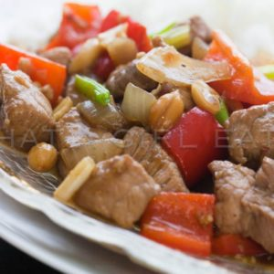 Szechuan pork stir fry is a quick and easy weeknight dinner, with tender pork loin, crispy vegetables, and a savory, spicy sauce.