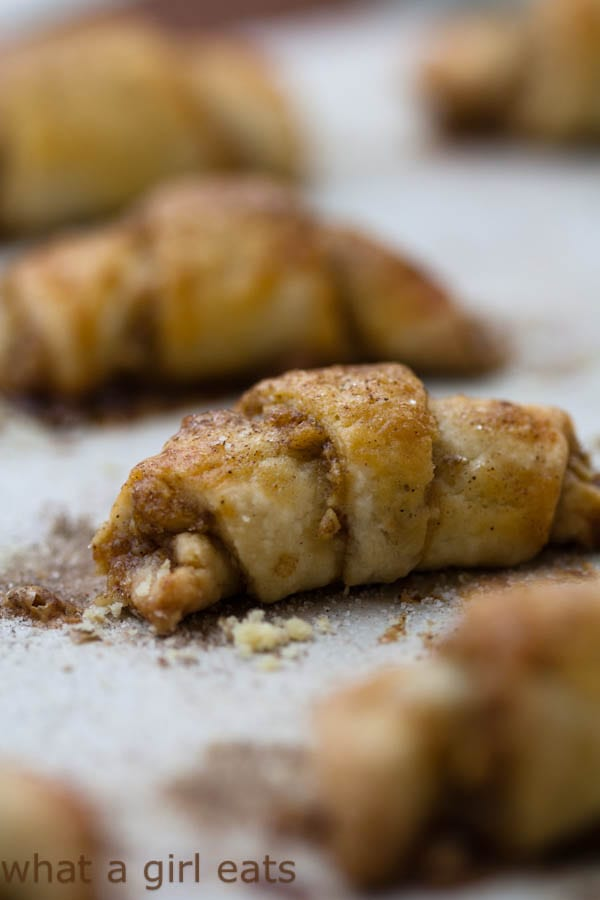 Rugelach are crescent-shaped cookies, traditionally served for Hanukkah, but the rich cream cheese dough and variety of possible fillings make this a delicious any-holiday cookie recipe. This post includes a gluten-free rugelach cookie recipe | WhatAGirlEats.com