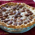 Chocolate chunk pecan pie is a delicious twist on traditional pecan pie recipe, with a vodka pie crust, and chunks of bittersweet and semi-sweet chocolate added to the filling.