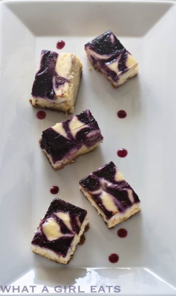 Lemon cheesecake  blueberry  swirl bars.