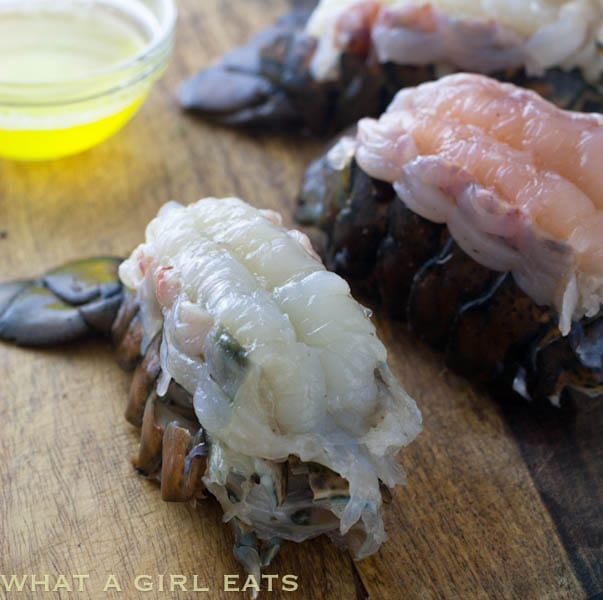 Broiled lobster tail is a decadent, impressive, but easy-to-make dinner. The preparation isn't difficult and this meal can be made at home for a fraction of the cost of eating out. | WhatAGirlEats.com