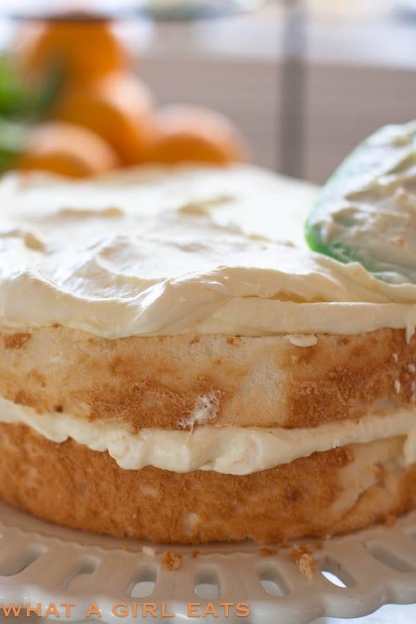 frosting the orange cream angel food cake