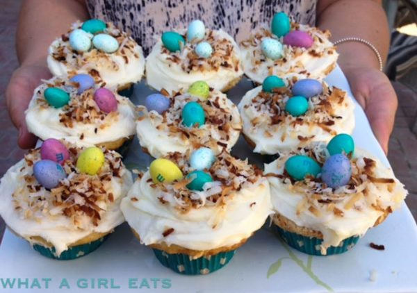 Coconut cupcakes are a beautiful and delicious Easter dessert, and these coconut cupcakes are adorned with toasted coconut bird's nests, making them perfect for any spring brunch. | WhatAGirlEats.com