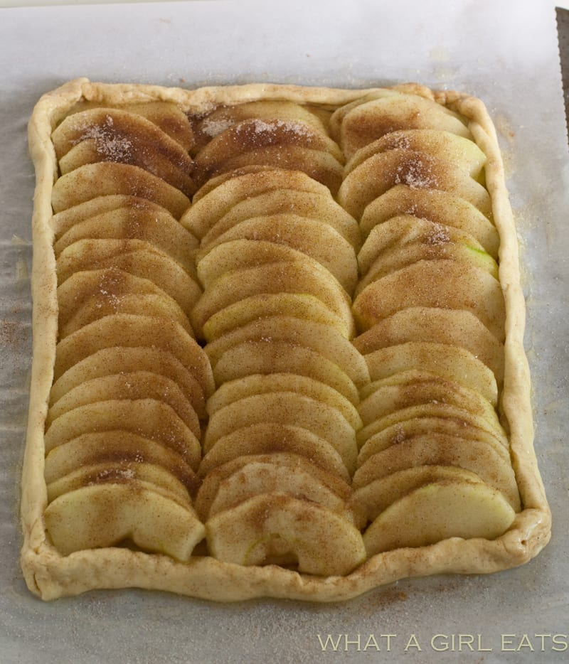 Caramel Apple tart.Line the apple in rows. Sprinkle with cinnamon sugar.
