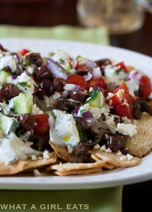 Greek nachos are great as a snack, appetizer, or even a main dish. Crispy pita chips are covered with seasoned lamb, olives, tomatoes, cucumber, onion, Greek spices and two types of cheese.