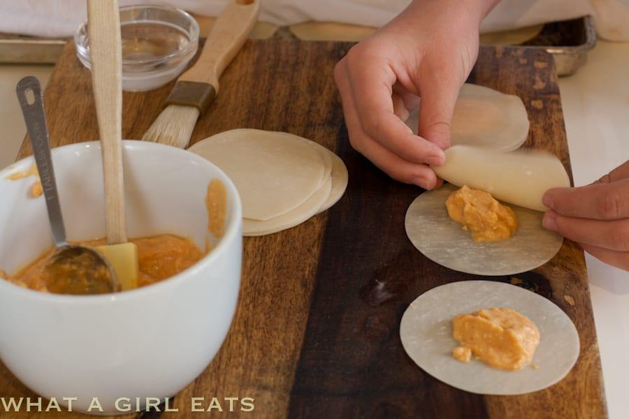 preparing Pumpkin Ravioli using won ton skins